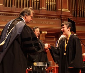 President Tony Woodcock Presents Nell with Her Diploma.